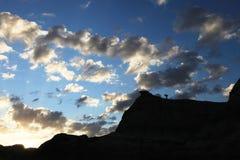 Een fotograaf onder wolken Stock Foto