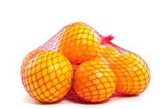 Een fruitbag van gezonde sinaasappelen Stock Foto's