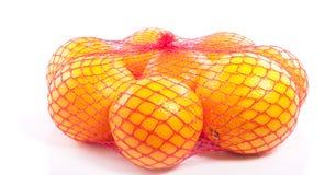 Een fruitbaghoogtepunt van gezonde sinaasappelen Stock Afbeeldingen