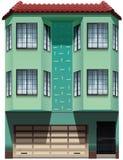 Een gebouw met een garage in bijlage Stock Foto's