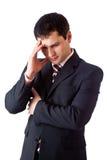 Een geconcentreerde mens denkt hard over Stock Foto's
