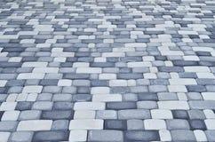 Een gedetailleerde die foto van het vierkant, van moderne straatsteen met rond gemaakte hoeken wordt opgemaakt Nauwkeurig ontwerp stock afbeelding