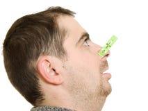Een geduldige mens met een muffe neus royalty-vrije stock afbeeldingen
