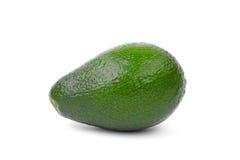 Een gehele avocado op een witte achtergrond Een voedzaam avocadohoogtepunt van vitaminen Een avocado voor een heerlijke guacamole Stock Foto's