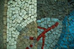 Een gekleurde decoratieve straatsteenachtergrond met bloemenpatroon Stock Foto