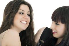Een gelukkige die meisjesvrienden - over een witte achtergrond worden geïsoleerd Royalty-vrije Stock Foto's