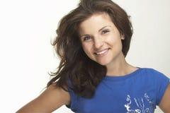 Een gelukkige jonge vrouw Stock Afbeelding
