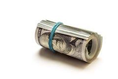 Een gerolde 100 die dollarrekening op witte achtergrond wordt geïsoleerd Stock Foto's