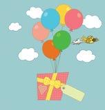 Een gift die door ballons wordt gedragen Royalty-vrije Stock Afbeelding