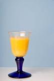 Een glas jus d'orange Stock Afbeelding