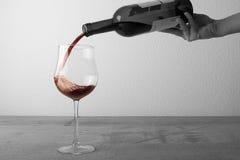 Een glasaf rode wijn Stock Afbeelding