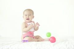 Een glimlachende baby Stock Afbeeldingen