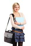 Een glimlachende student met een zak Stock Foto
