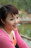 Een glimlachmeisje Stock Afbeelding