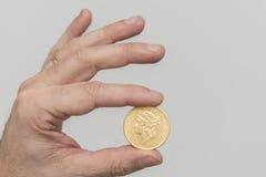 Een gouden muntstuk Stock Fotografie