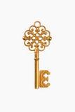 Een gouden sleutel Stock Afbeeldingen