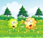 Een groen en oranje monster dichtbij de pijnboombomen Royalty-vrije Stock Foto's
