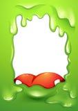 Een groene grens met een rode tong van een monster Stock Foto