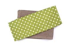 Een groene lijstkleren van het stip geruite servet op witte backg Stock Foto's