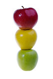 Een groene, rode en gele appel in een rij Stock Afbeelding