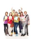 Een groep jonge tieners die notitieboekjes houden Stock Fotografie