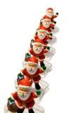 Een groep Kerstman `s op de witte achtergrond stock foto