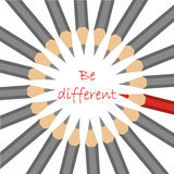 Een groep standaard grijze potloden en één rood met motto - ben dif Royalty-vrije Stock Foto's