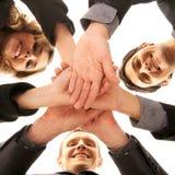 Een groepshanddruk tussen businesspersons royalty-vrije stock foto