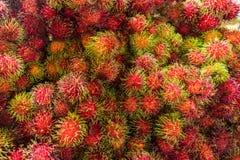 Een grote lading van verse Rambutans Stock Foto