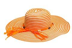 Een grote oranje dameshoed Stock Foto