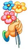 Een hand die drie bloemen houden Royalty-vrije Stock Fotografie