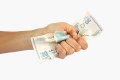 Een hand met geld Stock Fotografie