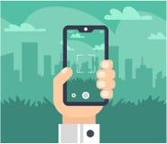 Een hand met een telefoon neemt beelden van de stad royalty-vrije illustratie