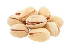 Een handvol pistaches. stock fotografie