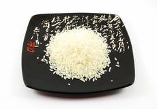 Een handvol van rijst op plaat Royalty-vrije Stock Foto's