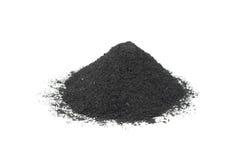 Een handvol van zwart zwart poeder Stock Fotografie