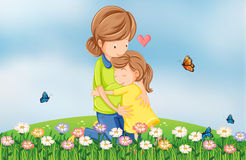 Een heuveltop met een moeder die haar kind troosten Stock Foto