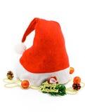 Een hoed van de KerstmisKerstman met gift en speelgoed op wit Stock Fotografie