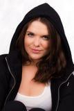 Mooie vrouwelijke trainer met verbindingsdraad met een kap Royalty-vrije Stock Foto's