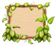 Een houten banner met groen blad vector illustratie
