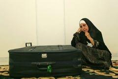 Een Iraakse vluchtelingsvrouw bij haar huis, Kaïro. Stock Foto's