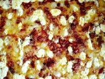 Een Italiaanse heerlijke pizzatextuur stock foto