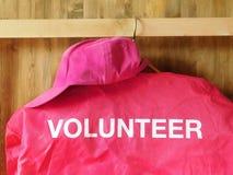 Een jasje met een woordvrijwilliger op het stock fotografie