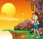 Een jong meisje dichtbij de klip die een kleine schop houden royalty-vrije illustratie