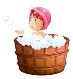 Een jong meisje die met de bellen spelen terwijl het nemen van een bad stock illustratie