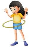 Een jong meisje die met een hulahoop spelen Stock Afbeeldingen