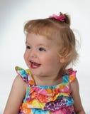 Een jong meisje laghs en glimlachen Stock Foto