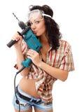 Een jong meisje met boringsmachine Stock Fotografie
