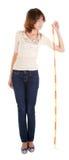 Een jong meisje met de meter in de hand Royalty-vrije Stock Fotografie