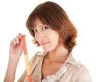 Een jong meisje met de meter in de hand Stock Fotografie